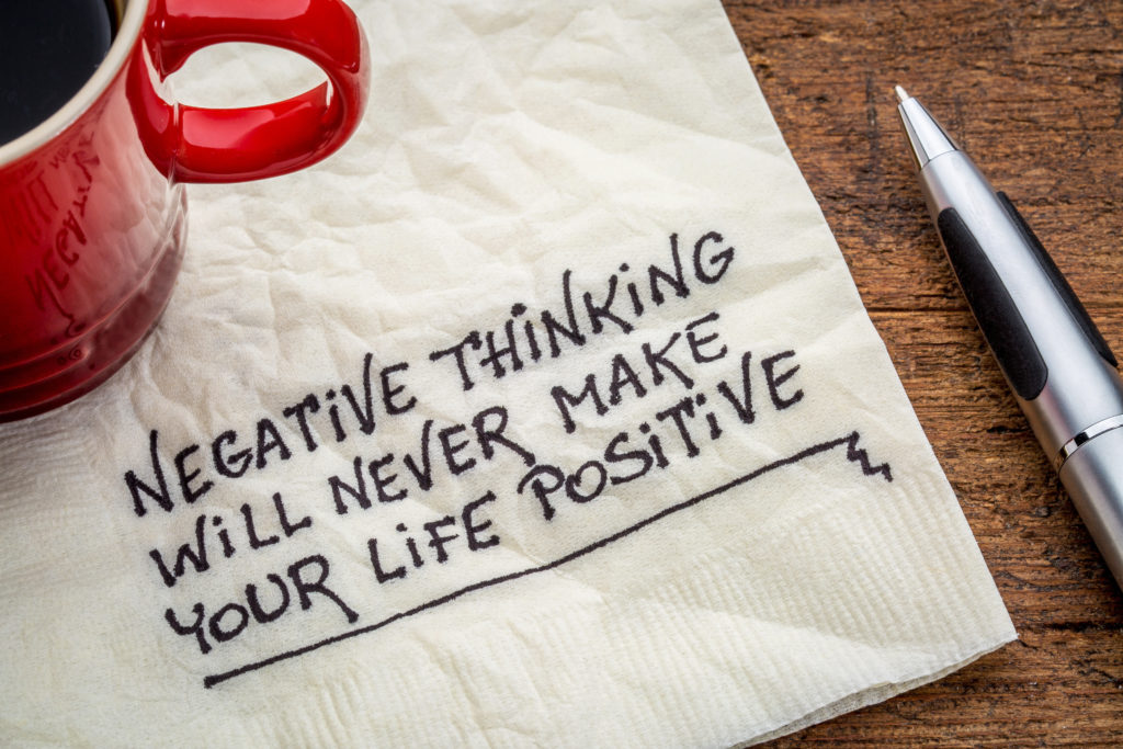 negative thinking will never make your life positive - inspirational handwriting on a napkin with a cup of coffee